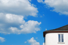 House and heaven Stock Photography