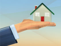 Home Ownership. House held in hand representing buying a home Royalty Free Stock Photos