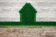House of Herbs. House from the grass on a concrete wall Stock Photography
