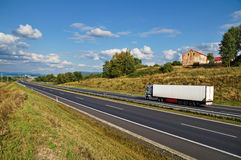 House of highway in a rural landscape, truck on the road Stock Photography