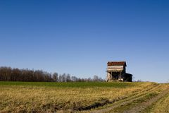 House on the Hill. An abandoned farm house on a hill Stock Photo