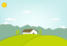 House on a hill on background of mountains Royalty Free Stock Images