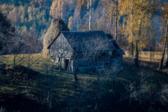 House on a hill covered in fog near Brasov, Romania Royalty Free Stock Photography