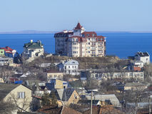 House on the hill near the sea Royalty Free Stock Image