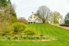 House on a hill overlooking a garden. Large house on a hill overlooking a garden Stock Photography
