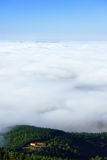 House on a hill with sea of clouds. House on a hill with a sea of clouds Royalty Free Stock Photos