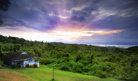 House in hill with sunrise Stock Image