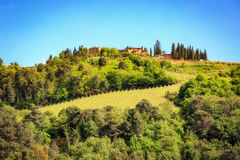 House in The Hillside of Chianti Italy. Greve in Chianti, Italy - May 15, 2017: A home on a wine vineyard sits on top of a hill in the Chianti region of Tuscany royalty free stock photography