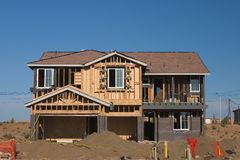 House and home. A new house and home under construction stock image