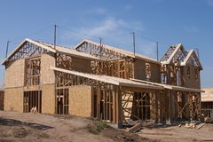 House and home. New house and home under construction stock photos