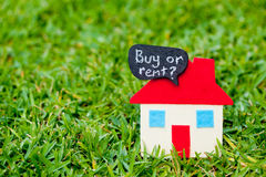 House - Home - Buy or Sell - on grass Stock Photo