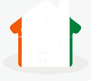 House home icon with Ivory Coast flag in puzzle Royalty Free Stock Photo