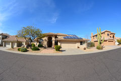 House with Rooftop Solar Panels Royalty Free Stock Photography