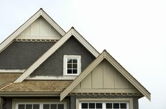 House Home Roof Stucco Siding. New home exterior roof details royalty free stock photography
