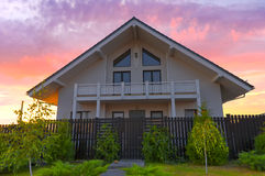 House. Home sweet home. Hearth and home. Beautiful two-story house at sunset. House. Home sweet home. Hearth and home royalty free stock image