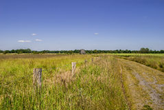 House on the Horizon. Rural spot - bright day - clear sky Stock Photos