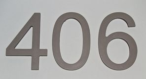House or hotel room numbers on clear gray surface, For graphical concept royalty free stock photo