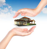 House in human hand Stock Image