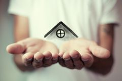 The house in human hands.  Stock Image