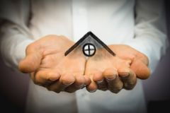 The house in human hands.  Stock Images