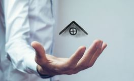 The house in human hands.  Royalty Free Stock Photo