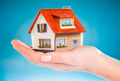 House in human hands Stock Photos