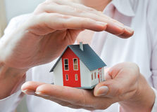 House in human hands. Hands presenting a small model of a house Stock Images