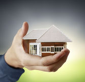 House in human hands Stock Image