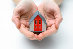 House in human hands. Hands presenting a small model of  house Royalty Free Stock Photography