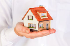 House in human hands Royalty Free Stock Image