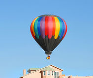 House hunting. Hot air balloon floating over a house in Albuquerque new Mexico Royalty Free Stock Images