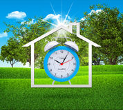 House icon with alarm clock Stock Images