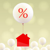 House icon and balloon with percent sign Royalty Free Stock Image