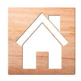 House icon carved in of wood, isolated. stock images