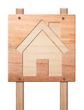 House icon  carved in of wood, isolated. Stock Photo