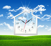 House icon with clock face Stock Image