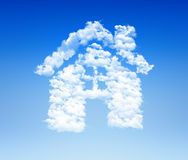 House icon cloud sky. House shaped cloud icon in blue sky Royalty Free Stock Photos