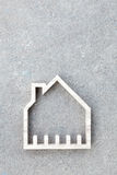 House icon on concrete background, Home construction Royalty Free Stock Images
