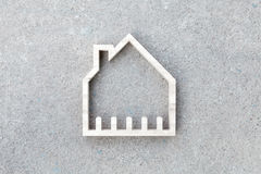 House icon on concrete background, Home construction Royalty Free Stock Photo