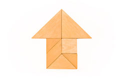 House icon. Flat lay - pictogram /symbol / icon of house made of wooden tangram pieces. White background royalty free stock photo