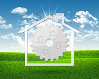 House icon with gear of puzzles Stock Photos