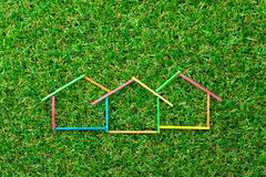 House icon on green field Royalty Free Stock Photo