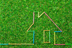 House icon on green field Royalty Free Stock Image