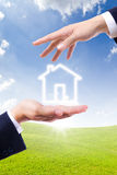 House icon on hand Stock Photo