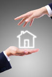 House icon on hand Stock Photography
