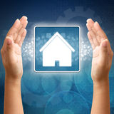 House icon in hand Royalty Free Stock Image