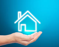 House icon in hand Stock Photos