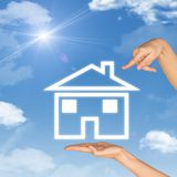 House icon on hand. Second hand points to house Royalty Free Stock Photography