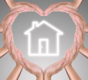 House icon in heart hand Stock Images