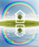 House icon on meadow Royalty Free Stock Photo